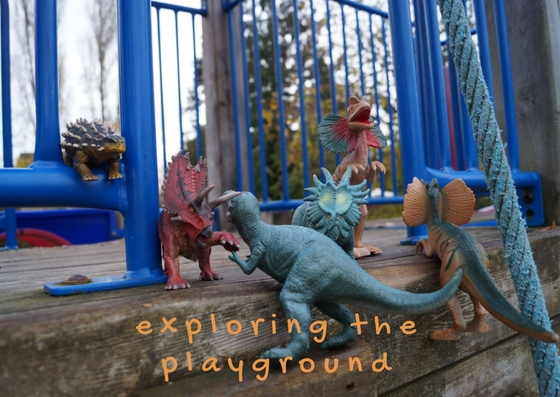 Dinosaurs at a playground