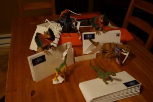 dinos making Christmas cards