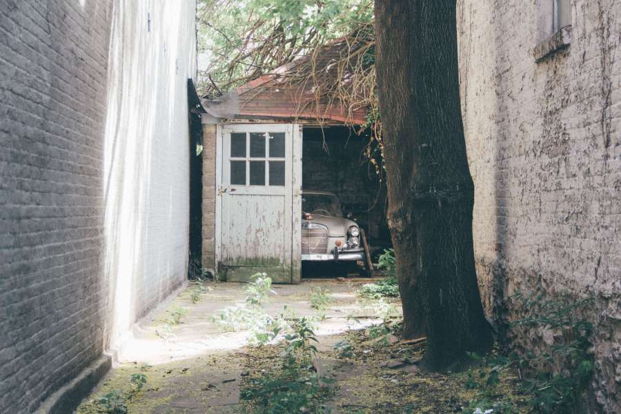 Car peaking out from old shed door