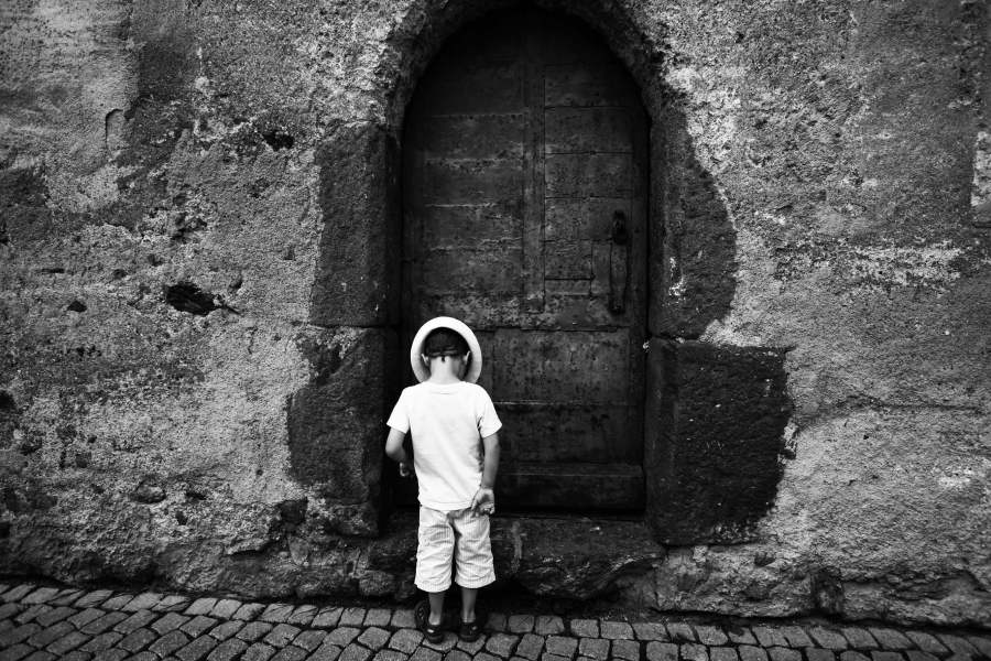 Boy standing at door