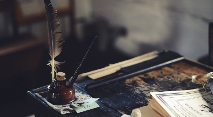 inkwell and feather pen