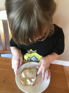 whipping cream on freshly baked bread