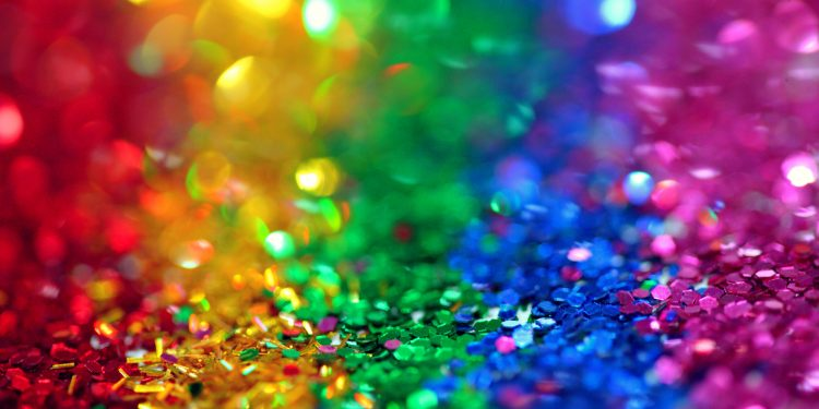a rainbow made of sparkle confetti
